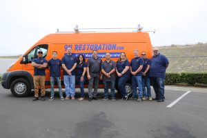 911-restoration-water-damage-mold-remediation-fire-damage-person-van-group-pic-background