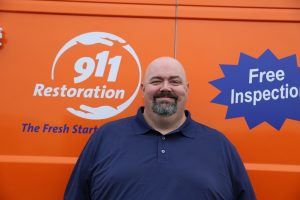 911-restoration-water-damage-mold-remediation-man-van